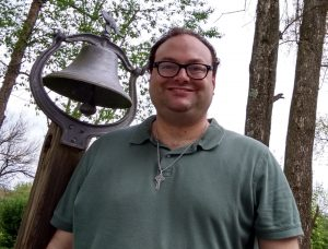 Me with a bell in the background.